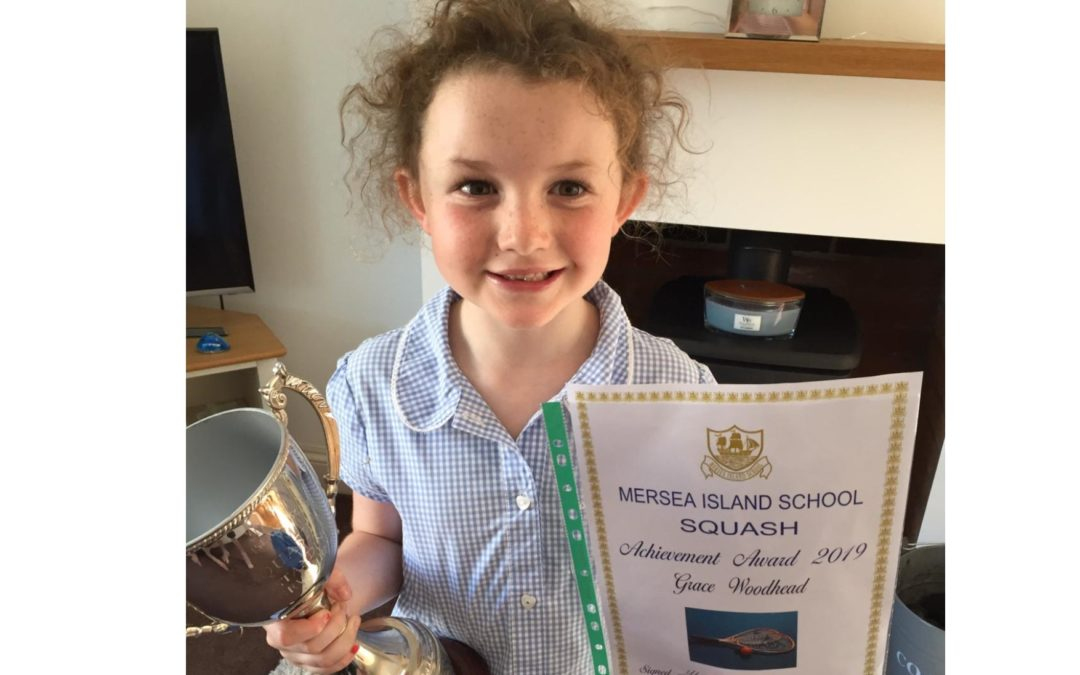 Amazing Grace lifts Mersea School Squash trophy, aged just 7